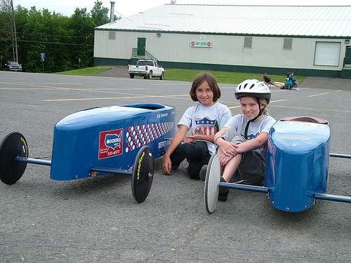 Waiting to soap box derby race in the next heat to determine the winner.