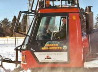 Maine Snowsled Groomer Taking Care Of Linneus ME Area Trails
