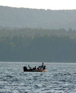 maine fishing boat on lake