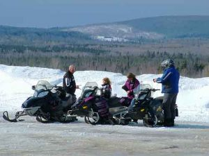 family snowmobiling maine trails