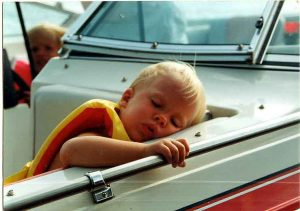 sleeping child in maine boat